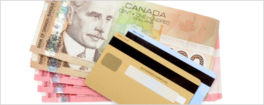 Canadian dollar bills and credit cards