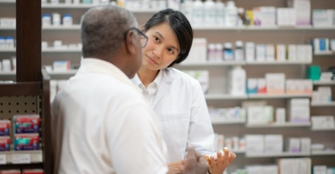 Two pharmacists standing and talking