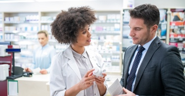 Pharmacist giving advice to a client