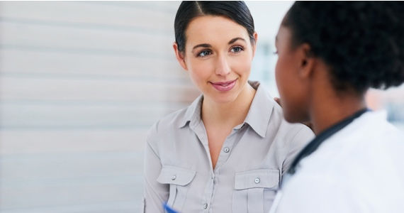 Woman talking with a health care professional