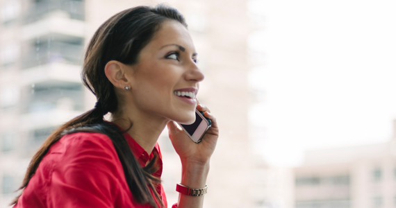 Smiling woman speaking on the phone
